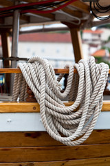 Rope bundle on a wooden boat side