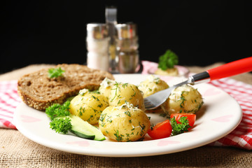 Young boiled potatoes on table, close up