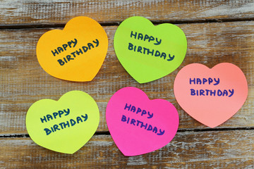 Happy birthday card with colorful paper hearts