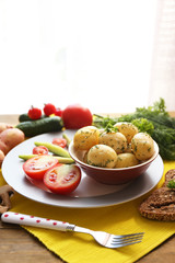 Young boiled potatoes with vegetables