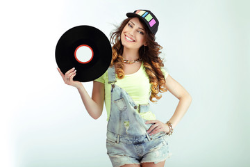 Amusement. Funny Woman holding Vinyl Record and Smiling