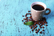 Polka dot mug of coffee beans isolated on white