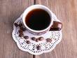 Cup of fresh hot coffee on wooden background