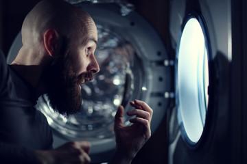 man next to a washing machine