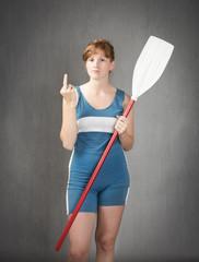 sportive girl showing rude gestures