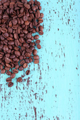 Coffee beans on blue wooden background