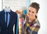 Tailor woman measuring business suit