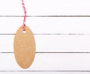 empty tag on white wooden background