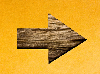 recycled paper and wood arrow