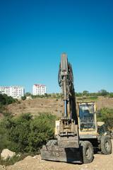 modern bulldozer digs the earthv