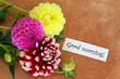 Good morning card with colorful dahlias on terracotta surface