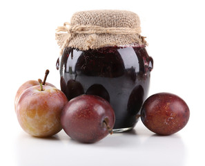 Plum jam and fresh plums isolated on white
