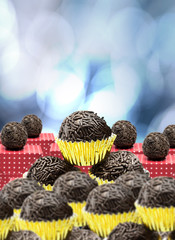 Lots of Brazilian Brigadeiro on bokeh background