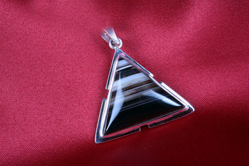 An antique Triangular Silver Pendant with Jasper stone kept on a