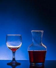 glass red wine blue background