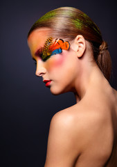 Woman with fashion feather eyelashes make-up
