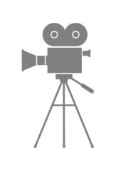 Grey movie camera on white background