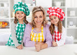 Woman and her little helper chefs