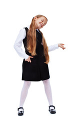 Happy little girl in stylish outfit with air guitar