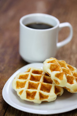 Breakfast with coffee and homemade waffles on wood table
