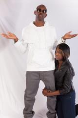 Black woman hugging a man's leg