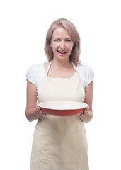 Beautiful woman holding a dish for a delicious meal