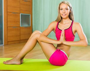 Female doing yoga at home