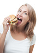 Funny girl eating burger isolated on white background