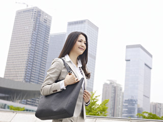 young asian businesswoman walking on street