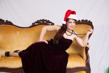 woman in a black dress and Santa Clause Hat