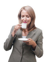 Business woman enjoying a cup of coffee isolated on white