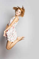 Slim red-haired girl in a jump