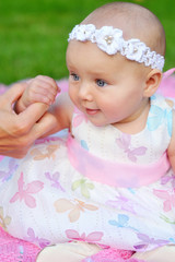 child, happiness and people concept - adorable baby girl