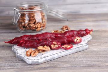 Tasty oriental sweets (churchkhela) and fresh nuts in glass