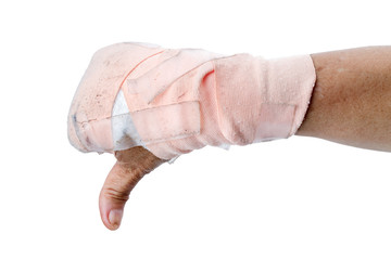 Thumb down showing by hand with bandages isolated on white