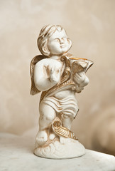 Angel with lyre, ornament. Golden ornament. Vintage angel