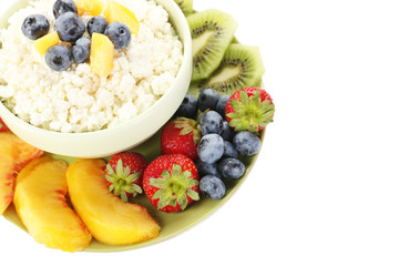 Cottage cheese with fruits and berries in bowl isolated on