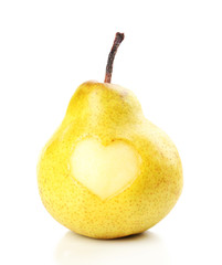 Ripe pear with heart isolated on white