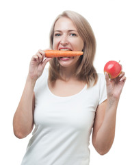 Beautiful woman with apple and carrot isolated on white backgrou