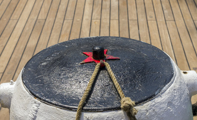 mooring rope tied on the bollards of old wooden ship