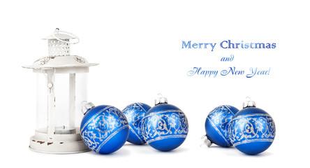 Blue Christmas balls and vintage lantern isolated on white backg