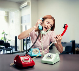 Stressed woman with three phones