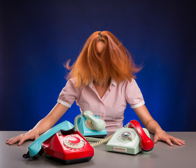 Exhausted woman with colorful phones