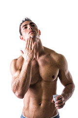 Man applying shaving cream on face