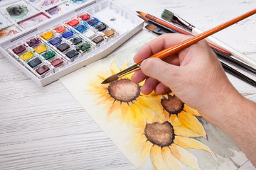 Watercolor painting sunflower with equipment