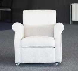 White second-hand chair in furniture warehouse
