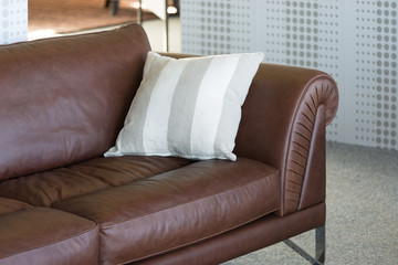 Brown leather bench in furniture showroom