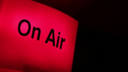 Side shot footage of an on-air sign