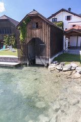 Wooden dock at alpine lake Mondsee, Austria..