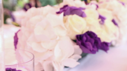 Wedding decoration with white and purple flowers, dolly